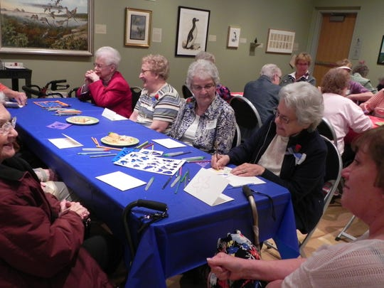 Honor Flight spouses participate in activities at the Woodson Art Museum.