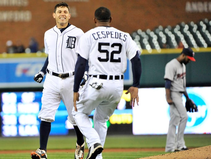 The Tigers' Ian Kinsler is all smiles and goes to celebrate