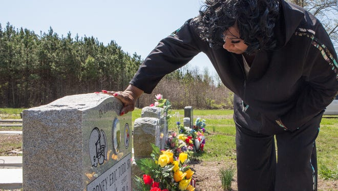 Bonnie Edwards, of Church Creek, visits her son, Rodney Todd's grave on Monday, April 4, 2016.
