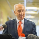 This file photo taken on Jan. 19, 2016 shows former Israeli president and Nobel Peace Prize winner Shimon Peres addressing journalists at the Tel Ashomer Hospital in Ramat Gan, near Tel Aviv, after treatment for a heart problem.