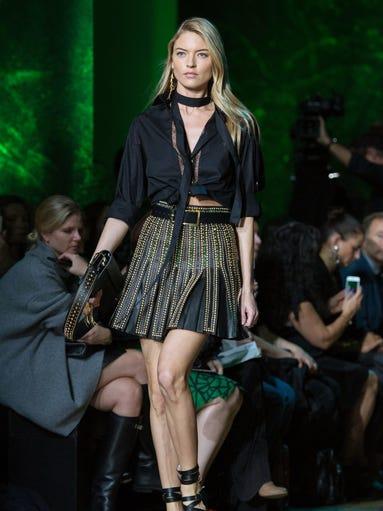 Martha Hunt models a 'Gladiator'-inspired skirt-and-sandal
