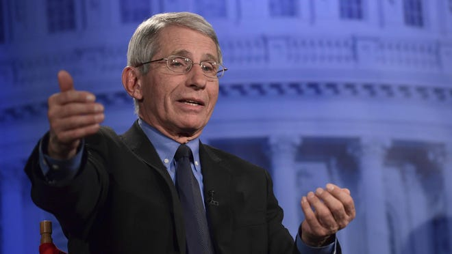 """Dr. Anthony Fauci of the National Institutes of Health listens to a question during an AP Newsmaker interview in Washington, Thursday, Jan. 18, 2018. (AP Photo/Susan Walsh)  Dr. Anthony Fauci of the National Institutes of Health speaks during an AP Newsmaker interview in Washington, Thursday, Jan. 18, 2018. (AP Photo/Susan Walsh)  Dr. Anthony Fauci of the National Institutes of Health listens to a question during an AP Newsmaker interview in Washington, Thursday, Jan. 18, 2018. Fauci says the National Institutes of Health is in a """"scramble"""" to prepare for a potential government shutdown at midnight Friday."""