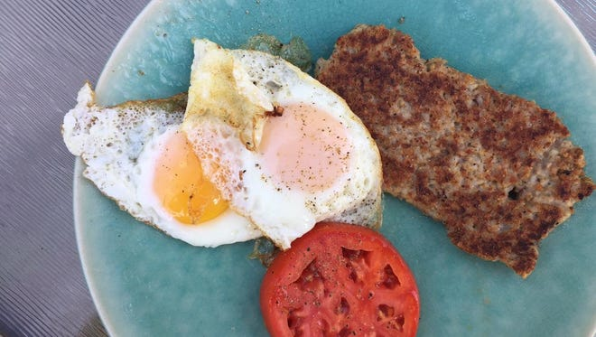 Goetta, eggs and a juicy, red tomato make a good breakfast.