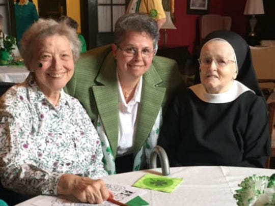 Sister Lisa Gambacorto, Ed.S., RSM, Directress of Mount Saint Mary Academy in Watchung, is pictured at center with Sister Mary Gomolka, left, and Sister Ruth Ann Balas during the St. Patrick's Day Tea for Sisters of Mercy on campus.