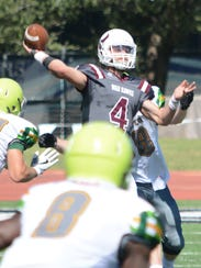 McMurry quarterback Kevin Hurley Jr. throws a pass