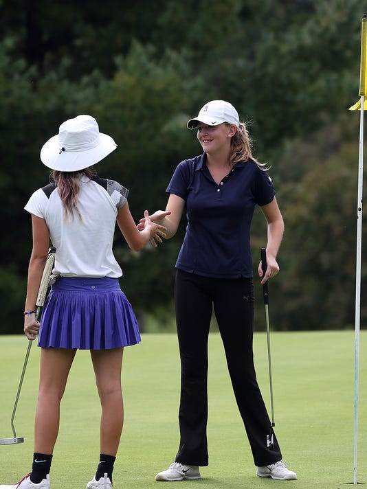 Manheim Twp.'s Adelyn Deery, right, shakes hands with Lancaster Mennonite's Grace Stillman, after beating her in a 2 hole playoff to win the girls title, during the LL Golf Championships at Tanglewood Golf Course Monday September 28, 2015. Chris Knight - GametimePa.com