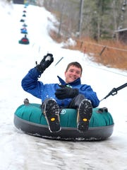 Family members and friends enjoy snow tubing Friday