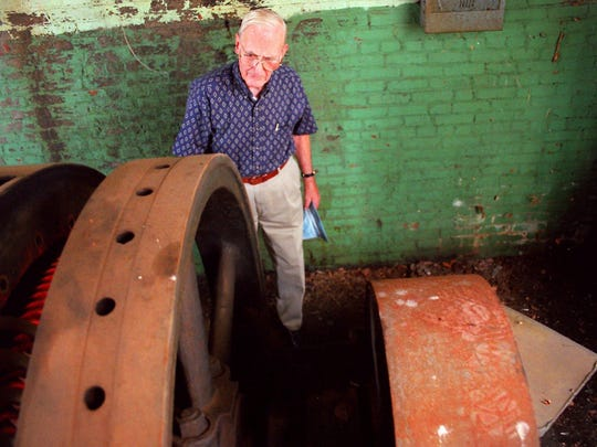 - Waldon Smithson looks over the remains of a Worthington air compressor that was used by the Dortch Factory when he worked there in the '30s and '40s. The plant has been renovated into The Factory at Franklin.
