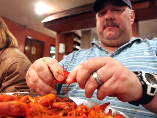 Customer Ronnie Duhon digs into crawfish at Lagneaux's