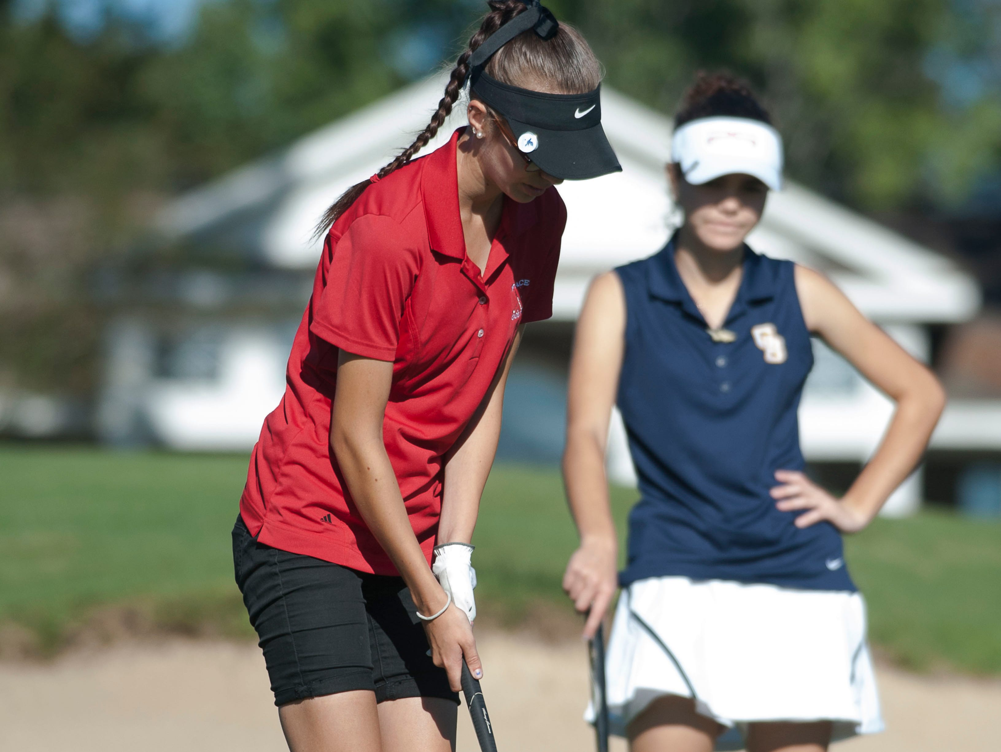 Pace High School's Dina Weaver finishes up her put during the District 1 2A golf tournament at Stonebrook Golf Club Wednesday Oct. 14, 2015.