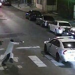 A video shows Edward Archer running with a gun toward a police car driven by Officer Jesse Hartnett in Philadelphia. Archer, using a gun stolen from police, said he was acting in the name of Islam when he ambushed Hartnett sitting in his marked cruiser at an intersection, firing shots at point-blank range, authorities said.