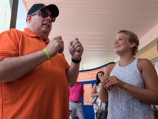 Maryland Gov., Larry Hogan, talks with fellow cancer