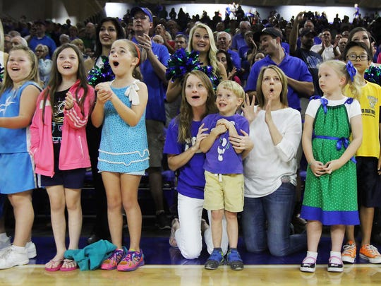 Fans line up at an FGCU men's basketball game to greet players at pregame introductions.