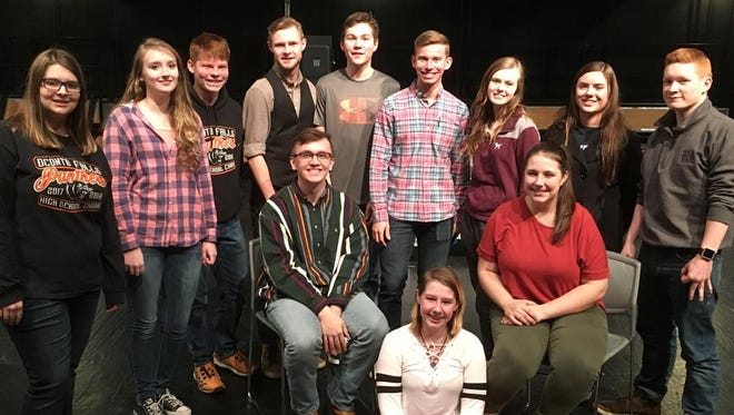 "The cast Oconto Falls High School Drama's upcoming production of ""Don't Drink the Water"" gathers for a photo after rehearsal."
