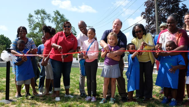 Mayor Mike Duggan and community officials cut the ribbon at the grand opening of Ella Fitzgerald park on Saturday, July 28, 2018.