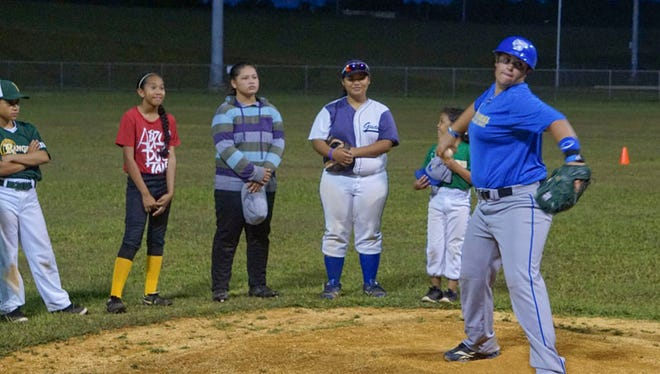 College and professional baseball player Oz Sailors, front, coached at the Guam Women's Baseball Clinic at Okkodo High School all week, a free event for girls and women interested in the sport.