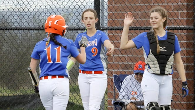 Madison Seelye (11) is congratulated by Haley Maggs (9) and Hailey Burdick after scoring a run for Edison on Friday in the IAC Large School championship game at Cornell University's Niemand-Robison Field in Ithaca.