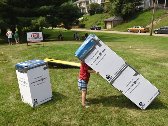 A youngster looks through a eclipse viewing box at