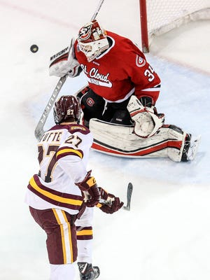 t012718 --- Clint Austin --- 012818.S.DNT.UMDMPUX.C01 --- Riley Tufte (27) of Minnesota Duluth shoots the puck on goal against St. Cloud State goaltender David Hrenak (34) during Saturday's game at Amsoil Arena in Duluth. --- Clint Austin / caustin@duluthnews.com