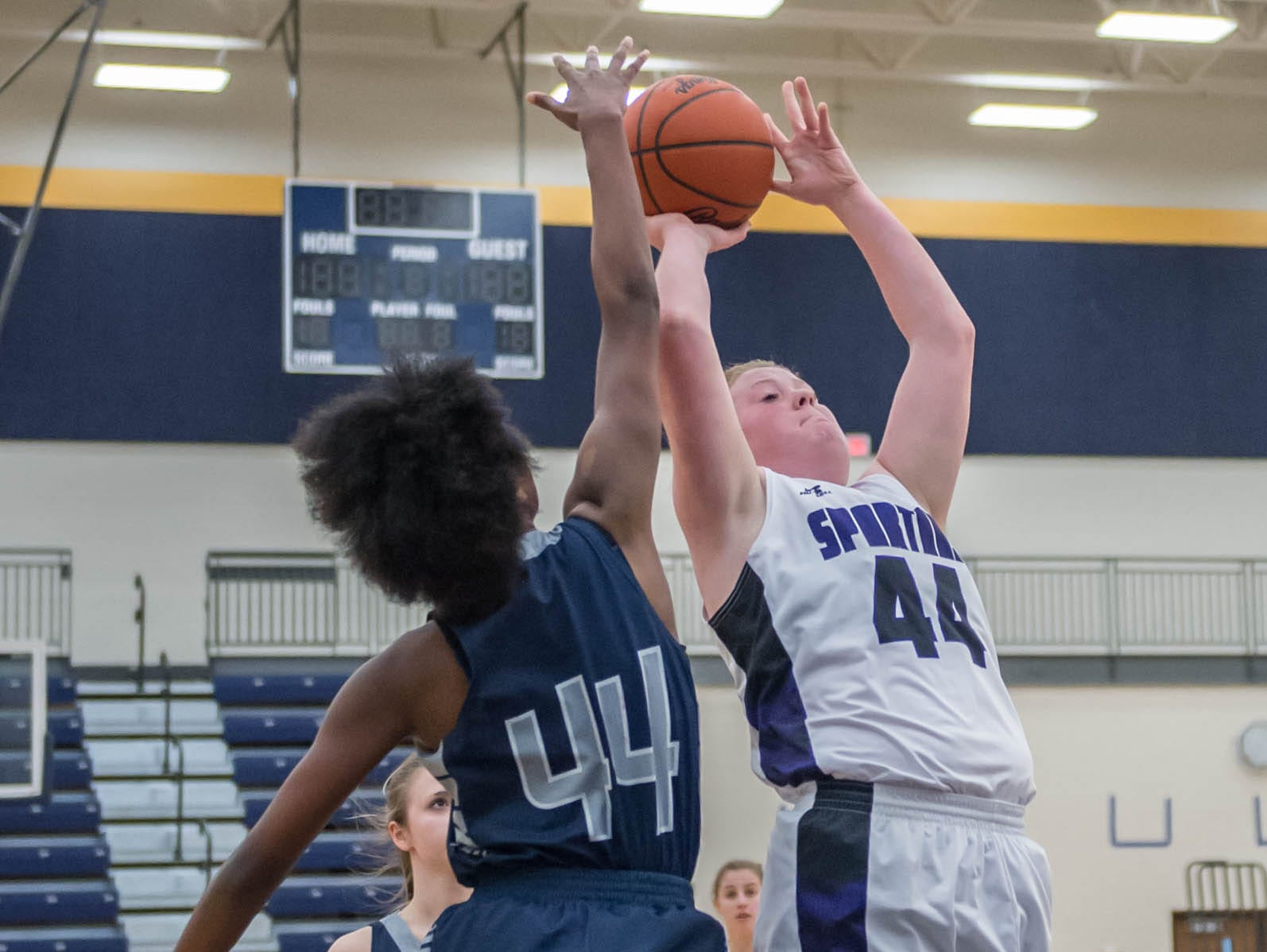 Lakeview's Emily Eldridge (44) goes to the hoop while being guarded by Gull Lake's Imani Morrow (44) Wednesday evening.