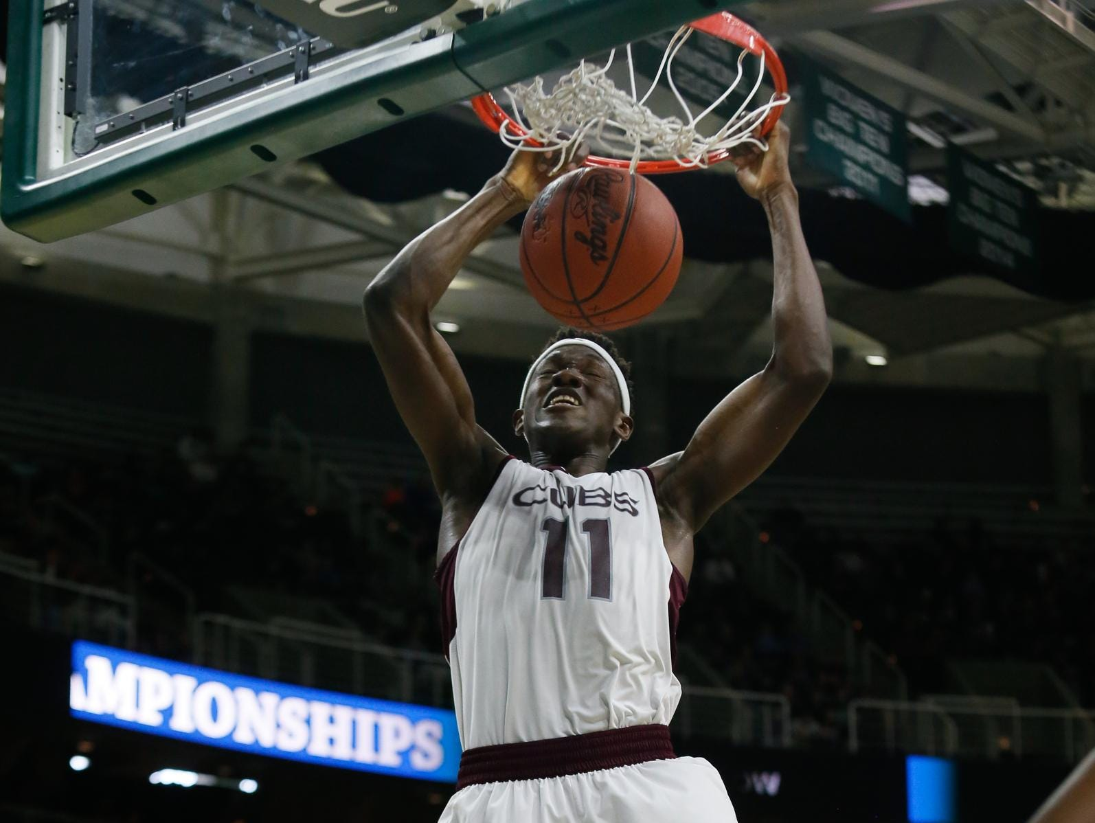 Detroit U-D Jesuit's Gregory Eboigbodin dunks the ball against Macomb Dakota during the MHSAA boys basketball Class A semifinals at the Breslin Center in East Lansing, Mich. on Friday, March 25, 2016. Eboigbodin scored 13 points in the 72-51 win.