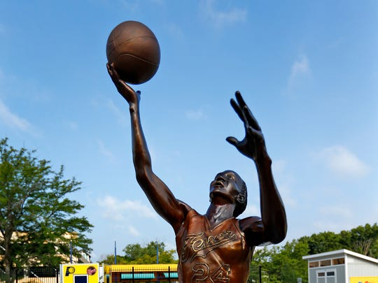 Tamika Catchings is portrayed in one of the new bronze statues of iconic Indiana sports legends to be unveiled Tuesday, July 24, 2018, in the Riley Children's Health Sports Legends Experience area at the Children's Museum of Indianapolis.