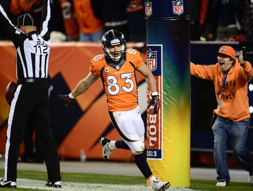 Denver Broncos wide receiver Wes Welker (83) reacts to his touchdown reception in the second quarter against the Oakland Raiders  at Sports Authority Field at Mile High.