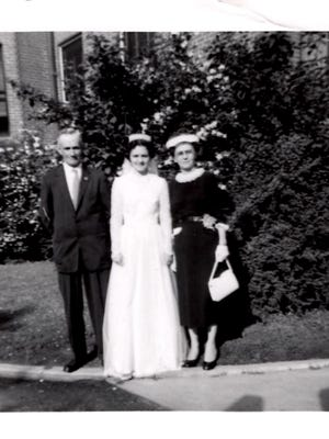 Sister Margaret with her parents, Peter and Catherine Mandernach, June 1957, on the day she entered the novitiate.