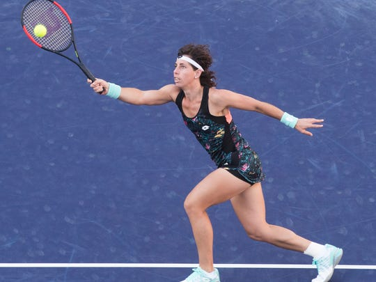 Carla Suarez Navarro of Spain plays against  Venus Williams of the United States of America  on Stadium One during their quarterfinal match at the 2018 BNP Paribas Open at Indian Wells Tennis Garden on March 15, 2018. Williams won the match 6-3, 6-2.