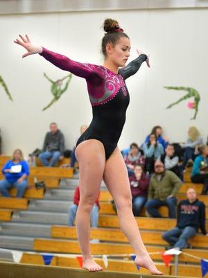 Kenosha Tremper junior Molly O'Boyle competes on the balance beam at the Warhawk Invitational gymnastics meet at Arrowhead High School in the Town of Merton on Saturday, January 23, 2016.