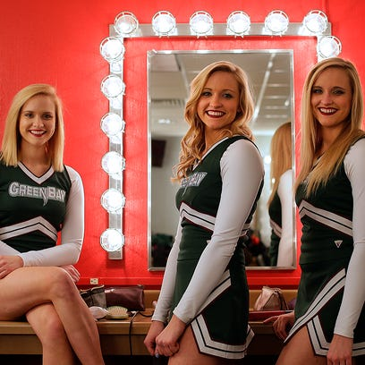 From left, Leah, Gabrielle and Hannah Buege share some laughs as they get ready for a portrait inside the Meyer Theatre in downtown Green Bay on Wednesday, Feb. 10, 2016. The triplets are cheerleaders at UW-Green Bay.