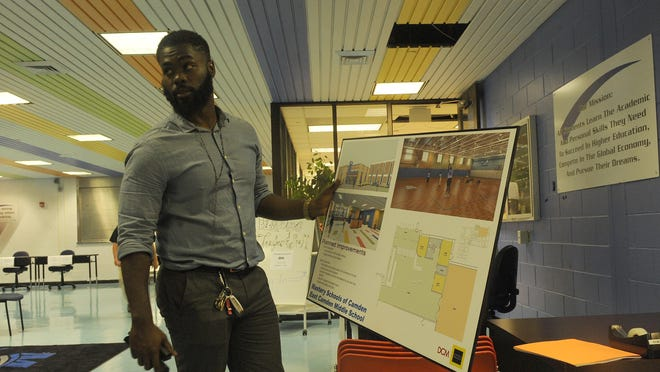Principal Will Hayes shows the plan renovations sections of the East Camden Middle School