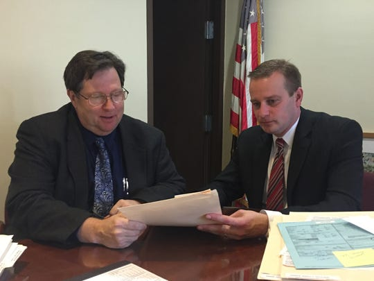 Broome County District Attorney Stephen Cornwell, right,