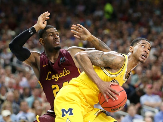 Michigan guard Charles Matthews is defended by Loyola-Chicago