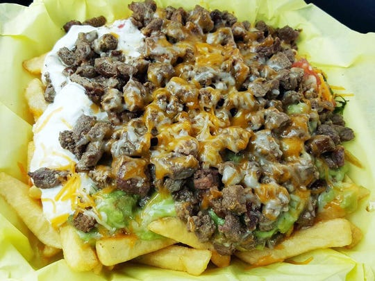Super fries ($7.37) are carne asada, topped with creamy guacamole, pico de gallo, cheese and sour cream.