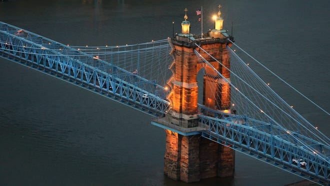 The John A. Roebling Suspension Bridge over the Ohio River. The bridge goes between Covington and Cincinnati and was completed in December of 1866.