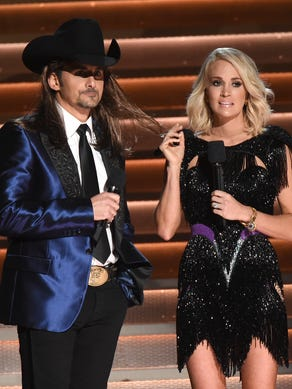 Hosts Brad Paisley and Carrie Underwood speak at the