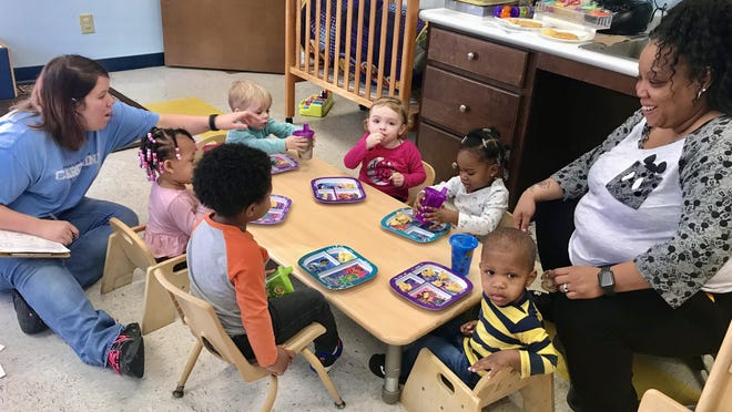 Kids, pre-COVID-19, in Cleveland County's Early Head Start Program enjoy snack time. Head Start in the county is getting a boost thanks to a federal grant that is predicted to bring $11 million to the program over the next five years.