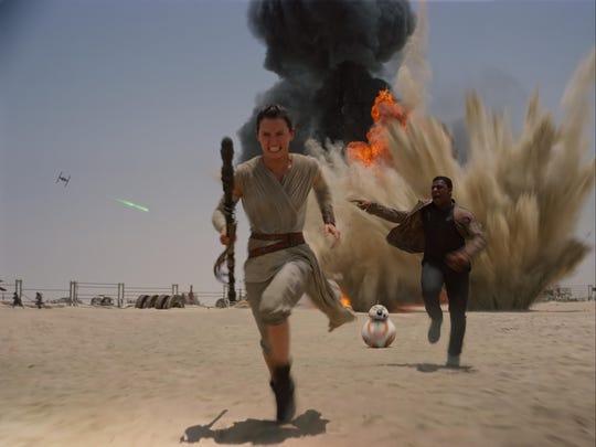 "Daisy Ridley and John Boyega star in ""Star Wars: The Force Awakens."""
