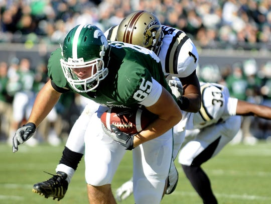 MSU tight end Garrett Celek grabs a pass and drags