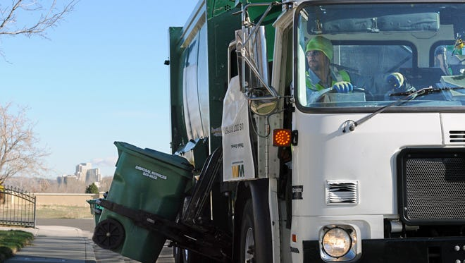 Waste Management driver Nick Dees collects garbage in southwest Reno.