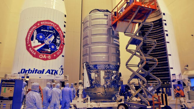 Crews ready the Orbital ATK Cygnus Spacecraft OA-6 named the S.S. Rick Husband Tuesday afternoon in NASA's Payload Hazardous Servicing Facility as they get it ready for a March 22nd Launch aboard a Atlas V rocket. The Orbital ATK Cygnus module is filled with cargo for the International Space Station.