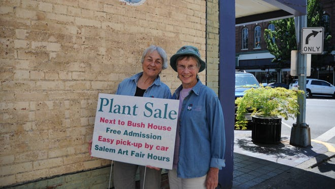 Gretchen Carnaby, left and Anita Engberg, are all smiles as they prepare for the Friends of Bush Gardens 34th annual art fair plant sale at the Salem Art Fair & Festival this weekend.