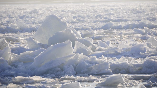 Ice jumbles and piles up in the St. Clair River.
