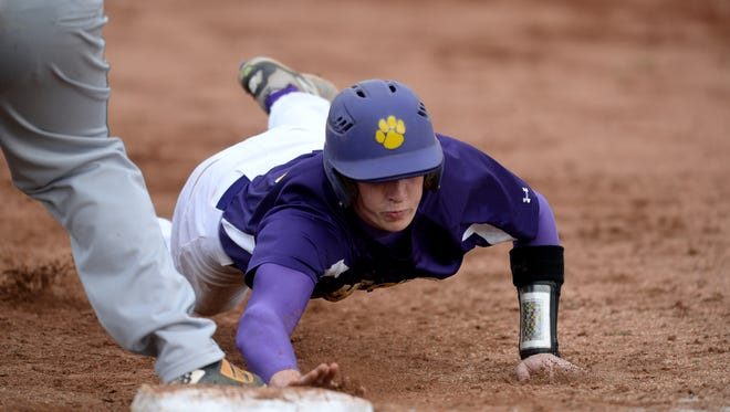 Hagerstown's Owen Golliher dives back to first against Northeastern during a baseball game Tuesday, May 3, 2016, on Lloyd Michael Field in Hagerstown.