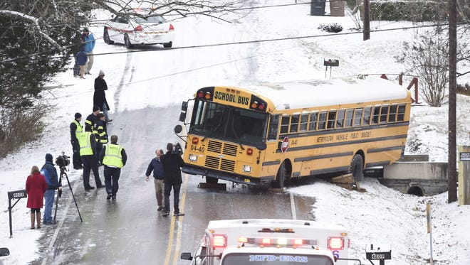 A school bus rests in the intersection of Humber Drive and Torbay Drive in Antioch after sliding off the road into a ditch with children on board Friday, Jan. 6, 2017.