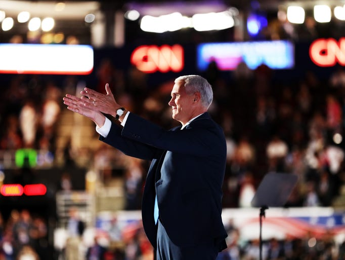 Republican vice presidential candidate Mike Pence gestures