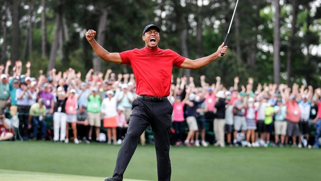 Tiger Woods celebrates winning the 2019 Masters during the final round of the Masters Tournament at Augusta National Golf Club.