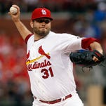 St. Louis Cardinals starting pitcher Lance Lynn throws during the first inning of Monday night's game against the Cincinnati Reds in St. Louis.