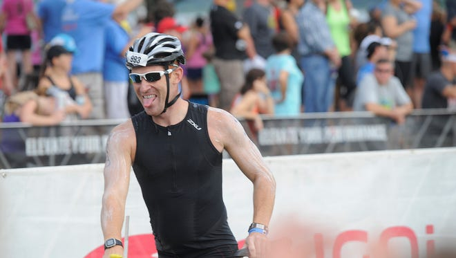 Pat Grau of Cincinnati prepares to take off for the 112-mile bike ride of Ironman Louisville on Sunday. (By David Lee Hartlage, Special to the C-J) Aug. 24, 2014.
